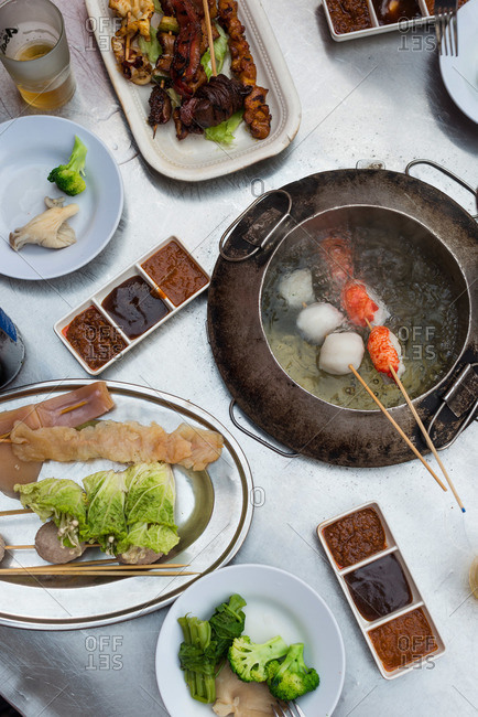 Overhead view of Malaysian hot pot dining table and foods