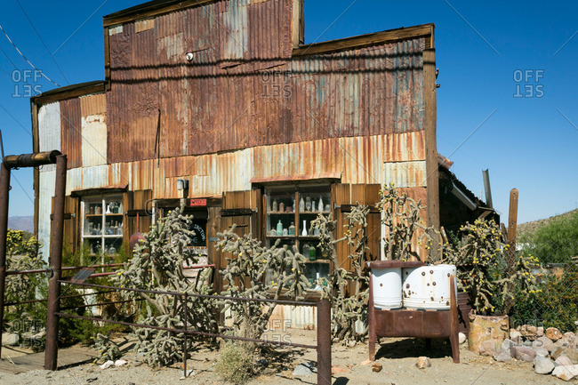 An old building with bottles in California mountains