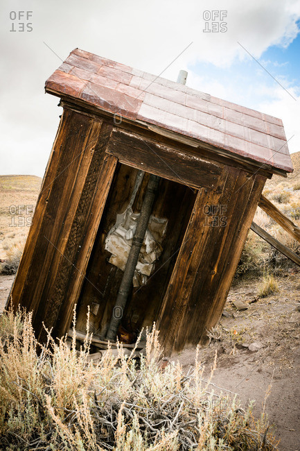 Crumbling outhouse in ghost town