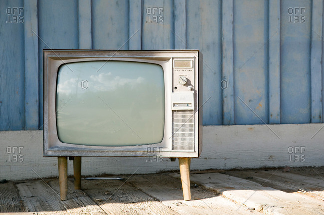 TV set in front of shed