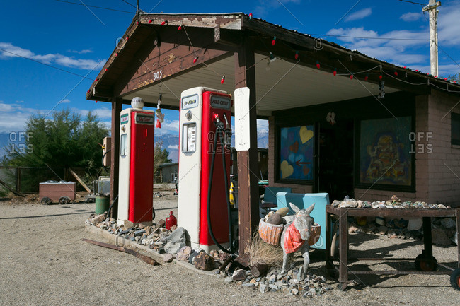 Abandoned gas station with eclectic art