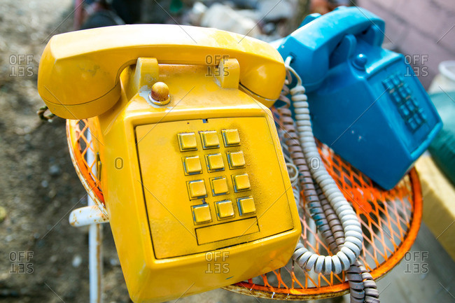 Painted telephones on a patio table