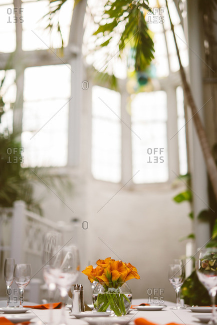 Orange lily centerpiece on a white table