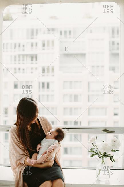 New mother gazes at her newborn baby