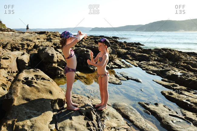 Two sisters playing on the beach at the Warrah lookout, Brisbane Water National Park, Patonga, Australia