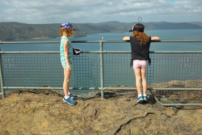 Two sisters looking at the bay at the Warrah lookout, Brisbane Water National Park, Patonga, Australia