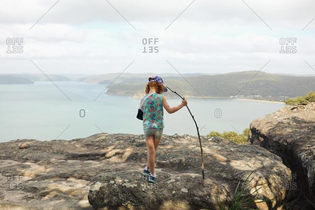 Little girl walking on rocks at the Warrah lookout, Brisbane Water National Park, Patonga, Australia