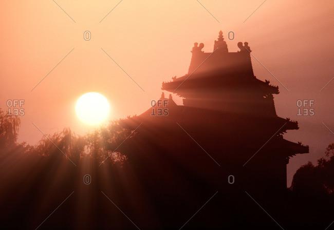Sun backlighting a Chinese pagoda