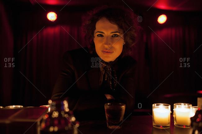 Woman sitting at a bar in a nightclub