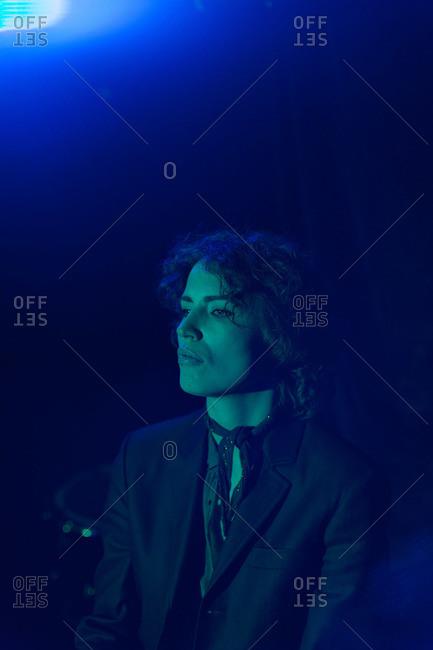Woman at nightclub with blue light