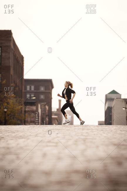Female runner jogging through town
