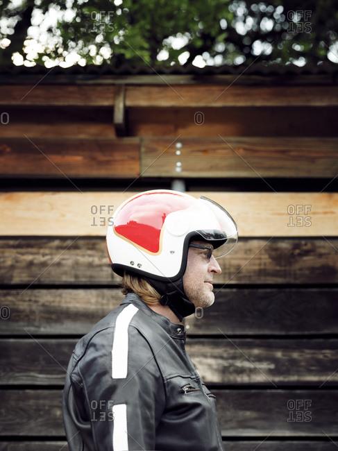 Profile view of man wearing helmet