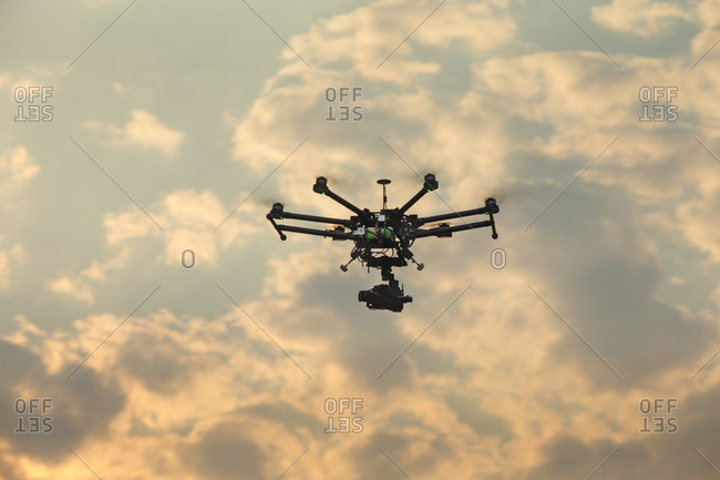 Drone flying with camera up in the clouds