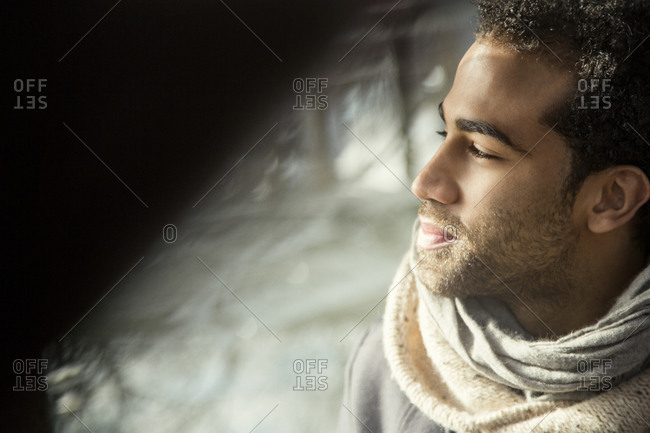 Close up of man with sun on his face
