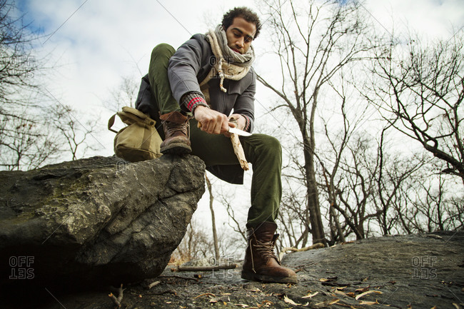 Man whittling wood