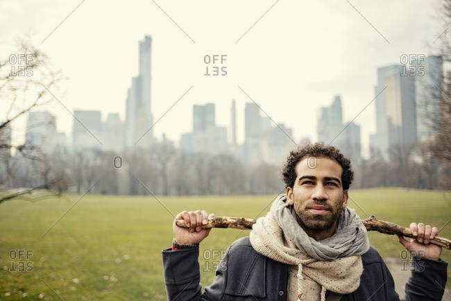 Close up of man holding stick