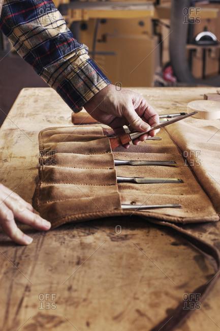 Carpenter putting his tools away