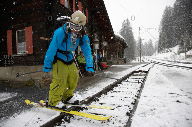 Skier at train station, Cavaduerli, Klosters, Canton of Grisons, Switzerland