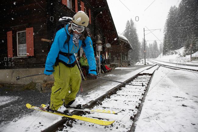 Skier at train station, Cavaduerli, Klosters, Canton of Grisons, Switzerland