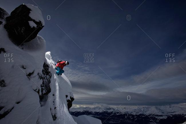 Female skier jumping, Chandolin, Anniviers, Valais, Switzerland