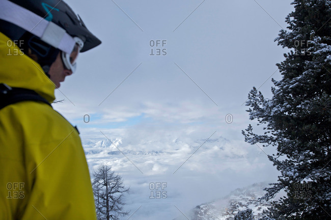 Snowboarder enjoying panoramic view, Chandolin, Anniviers, Valais, Switzerland