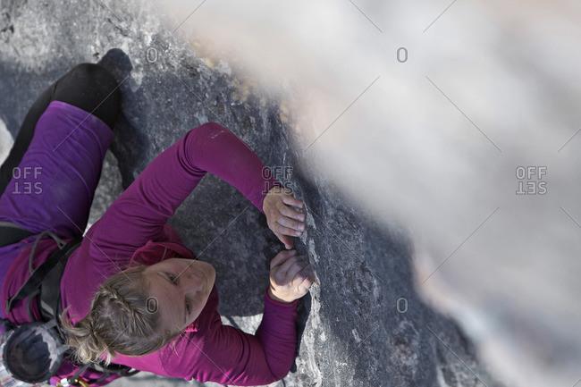 Young woman climbing on a rock face, Pinswang, Tyrol, Austria
