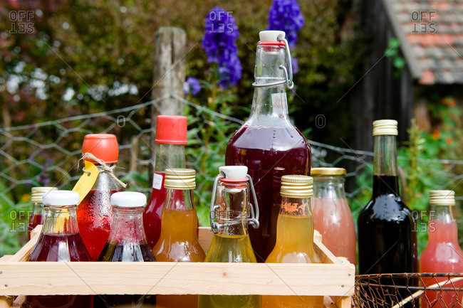 Homemade bottles of juice, sirup and liqueurs