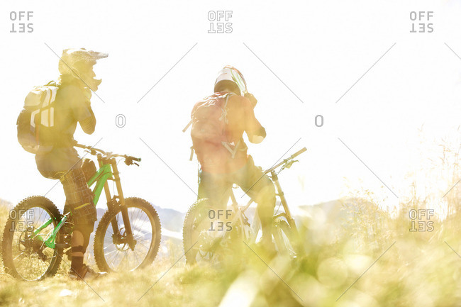 Two freeride mountain bikers off-roading, Chatel, Haute-Savoie, France