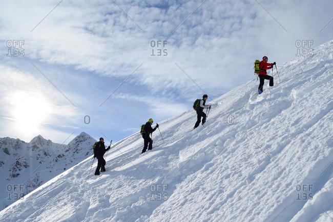 Group of backcountry skiers ascending to Sagtaler Spitzen, Kitzbuehel range, Tyrol, Austria