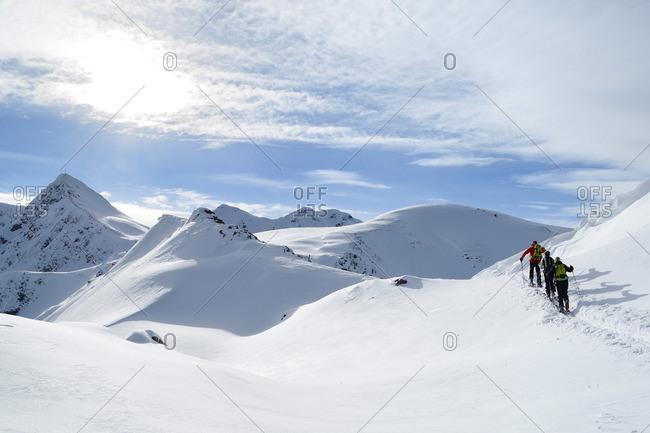 Group of backcountry skiers ascending to Sagtaler Spitzen, Kitzbuehel Alps, Tyrol, Austria