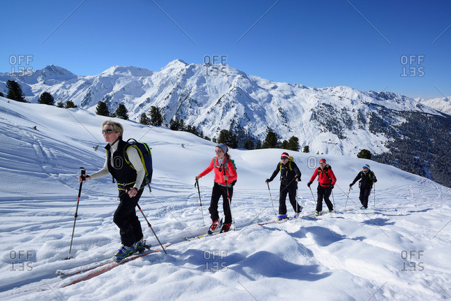 Group of backcountry skiers ascending to Hoher Kopf, Tux Alps, Tyrol, Austria
