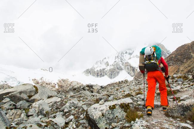 Man ascending to high camp of Ranrapalca, Ishinca Valley, Pashpa, Huaraz, Ancash, Cordillera Blanca, Peru