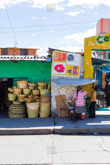 Huaraz, Ancash, Peru - June 5, 2013: Women chatting at a street market, Huaraz, Ancash, Peru