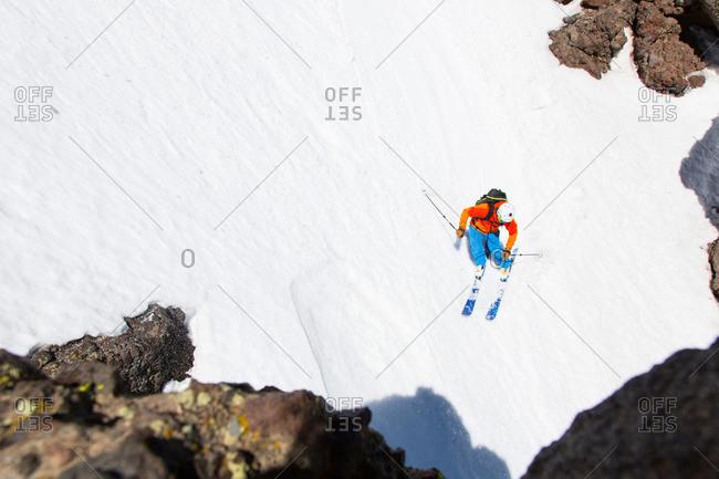 Man downhill skiing, Kirkwood ski resort, California, USA