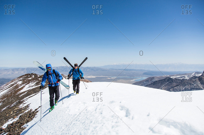 Two skiers on crest, Mammoth Lakes, California, USA