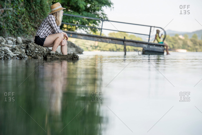 young women at the river bank of the Rhine, Rheinfelden, Baden-Wuerttemberg, Germany