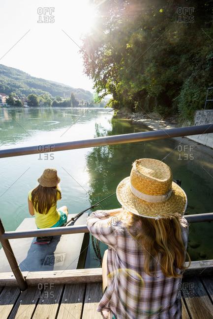 Two young women at river Rhine, Rheinfelden, Baden-Wuerttemberg, Germany