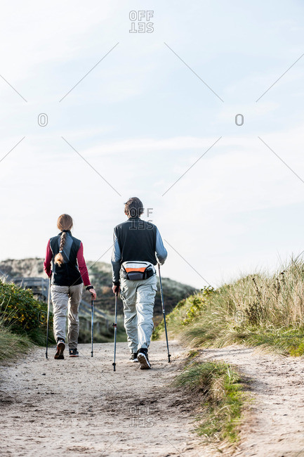 Two people Nordic walking in dunes, Kampen, Sylt, Schleswig-Holstein, Germany