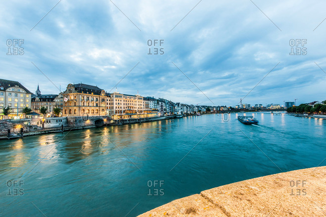 View over the river Rhine to a hotel in the evening, Basel, Canton of Basel-Stadt, Switzerland