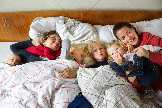 Two mothers with children in a bed, Goseck castle, Goseck, Saxony-Anhalt, Germany