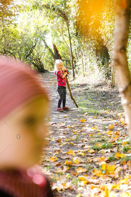 Girl playing in an autumn forest, Goseck, Saxony-Anhalt, Germany