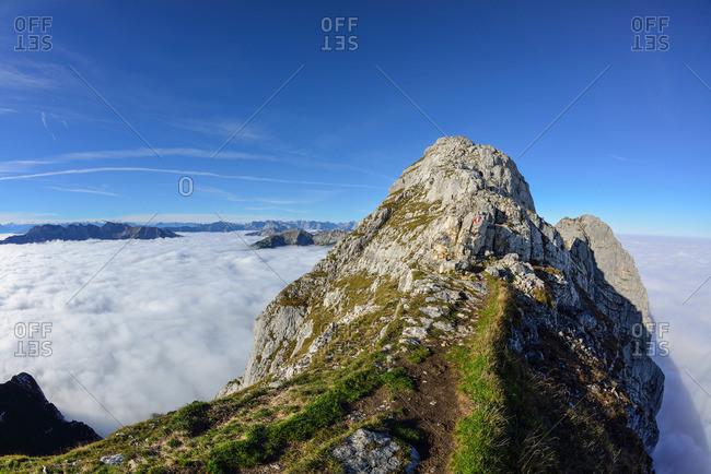 Path leading towards Guffert, sea of fog in the valley, Guffert, Rofan range, Tyrol, Austria