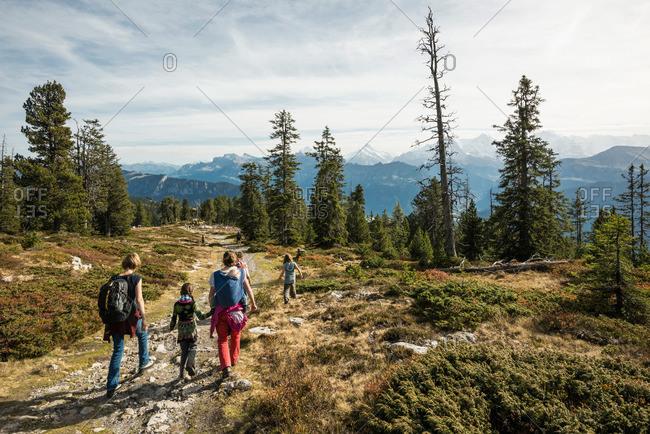 People hiking a trail at Niederhorn, Beatenberg, Bernese Oberland, Canton of Bern, Switzerland