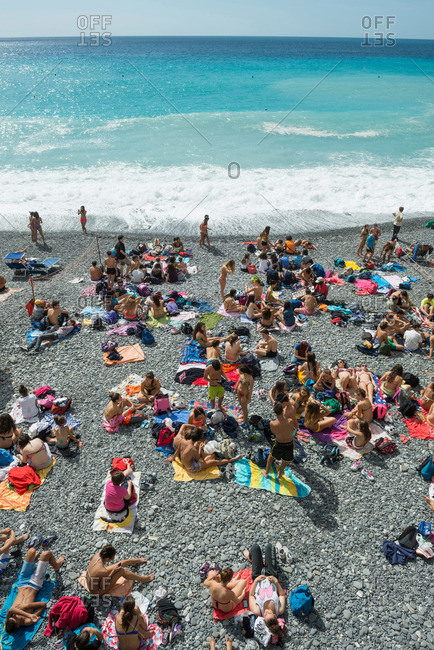 Genua, Italian Riviera, Liguria, Italia - September 19, 2013: Sunbathing at beach, Camogli, province of Genua, Italian Riviera, Liguria, Italia