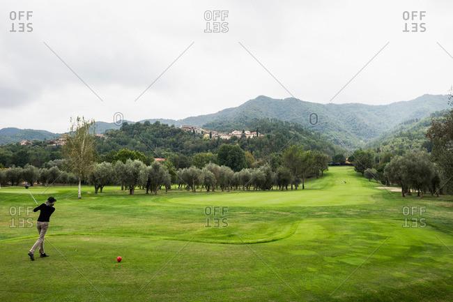 Person playing golf, province of Savona, Italian Riviera, Liguria, Italy