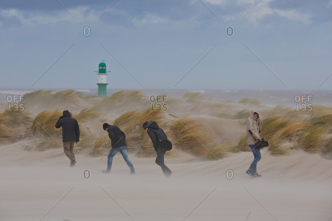 Dunes and lighthouse during a storm, Warnemuende, Baltic sea coast, Mecklenburg-Vorpomerania, Germany