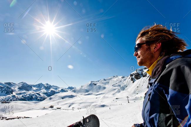 Obertauern, Salzburg, Austria - March 24, 2010: Snowboarder looking over slope, Obertauern, Salzburg, Austria