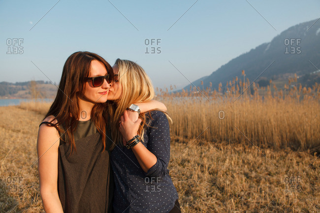 Two young women near Grosser Alpsee, Immenstadt, Bavaria, Germany
