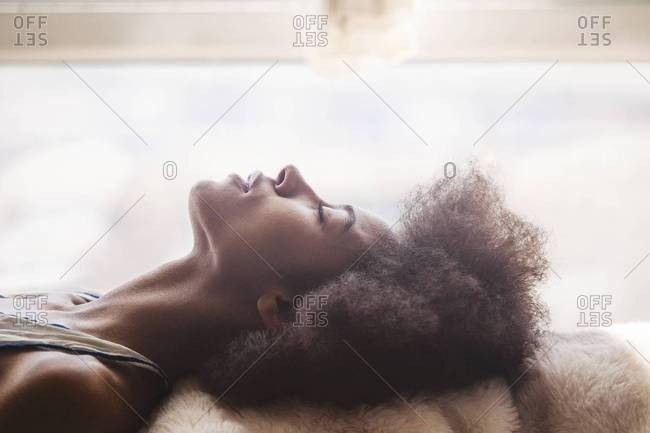 Profile of a woman lying down and relaxing