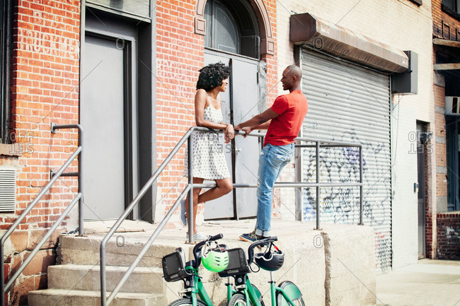 Urban couple talking outside a building